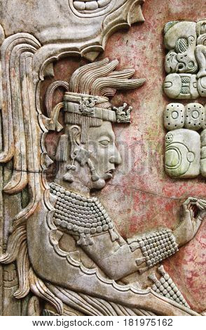 Barelief carving with of a Mayan king, pre-Columbian Maya civilization, Palenque, Chiapas, Mexico. UNESCO world heritage site