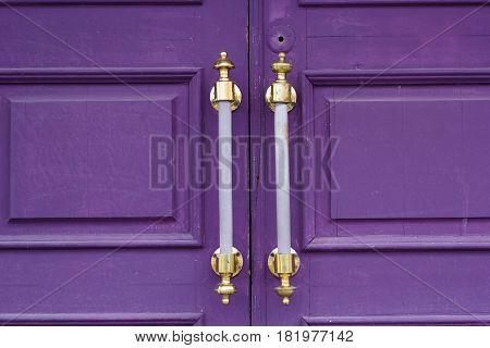 old massive purple wooden door close up