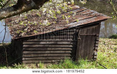Waterside boat shed in rural central France