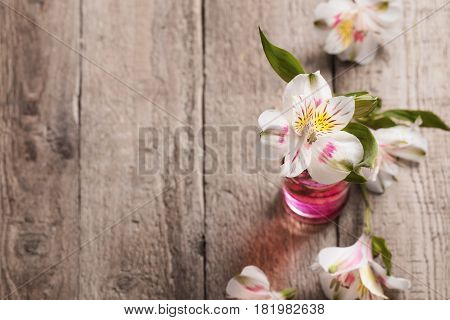 the beautiful alstromeria on old wooden background