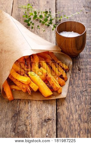 Baked butternut squash fries with sea salt. Pumpkin chips.