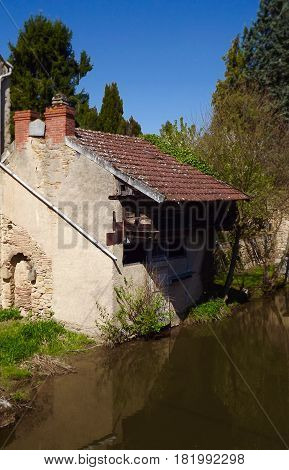 Ancient riverside house in La Chatre, central France