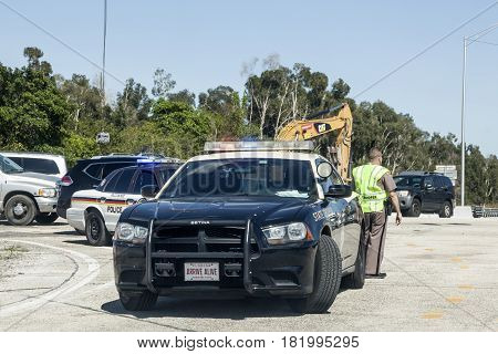 Miami Fl USA - March 21 2017: Police car and officers at the highway interection in Miami. Florida United States