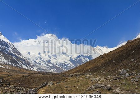 Himalaya Annapurna mountain range with blue sky on the way to Annapurna base camp famous trekking trail in Nepal.