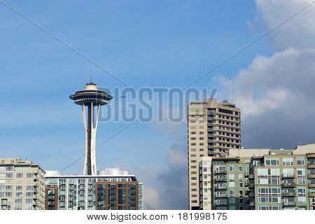 SEATTLE, WASHINGTON, USA - JAN 25th, 2017: A view on Seattle downtown from the waters of Puget Sound. Skyscrapers, Space Needle in Seattle city before sunset.
