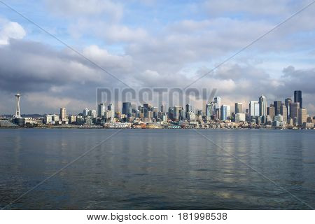 SEATTLE, WASHINGTON, USA - JAN 25th, 2017: A view on Seattle downtown from the waters of Puget Sound. Piers, skyscrapers, Space Needle and Ferris wheel in Seattle city before sunset.