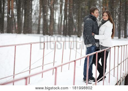 a pair of lovers on a date winter afternoon in a snow blizzard