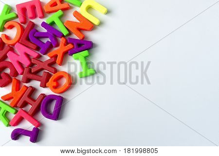 Wooden colored letters on a white background in various places.