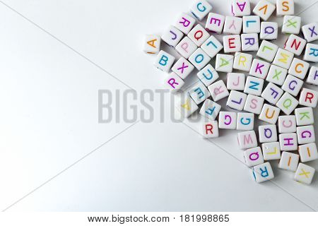 Many decorative white cubes with letters on a white background.
