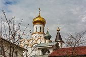 Belfry and gilded dome of the Church of St. Michael the Archangel poster