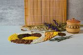Buckwheat grain, rice, corn, pea, semolina and lentil on a white wooden background in form of horn of plenty. Wooden solt shakie.Bunches of dried wheat ears, oats and poppy seeds. poster