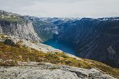 Beautiful norwegian vibrant summer landscape with fjord, mountain and lake, lake Ringedalsvatnet on the way to famous Trolltunga, Skjegeddal rock, near Odda, Hordaland, Norway. poster