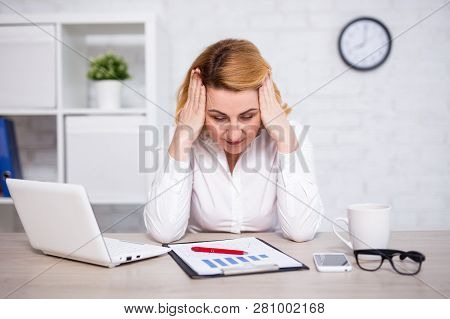 Business And Bankruptcy Concept - Portrait Of Sad Or Tired Mature Business Woman In Modern Office