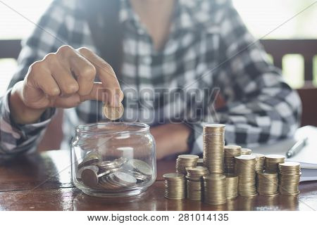 Businessman Holding Coins Putting In Glass. Concept Saving Money For Finance Accounting,  Coin Stack
