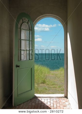 Arched Doorway To Beach
