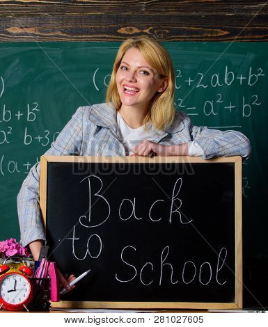 Study And Education. Modern School. Knowledge Day. Teacher With Alarm Clock At Blackboard. Time. Bac