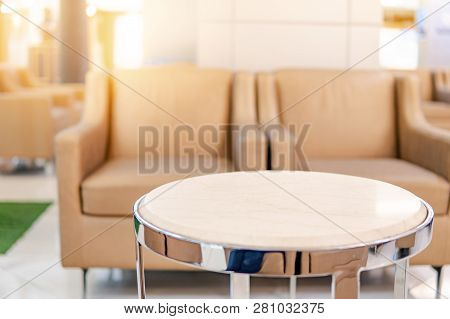 Table And Sofa In Waiting Area Of Luxury Hospital Or Hotel. Clinic Interior Background. Healthcare A