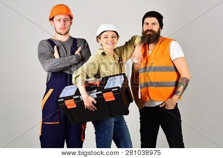 We Are The Great Team. Construction Workers Team. Professional Working Team. Men And Woman Builders