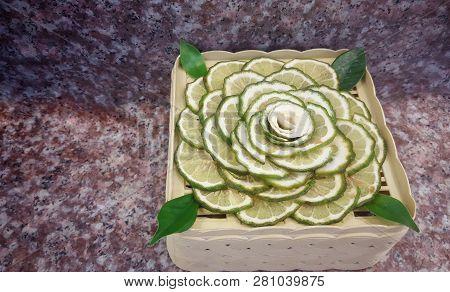 Juicy Slice Makrut Or Kaffir Lime With Green Bergamot On Wood Table