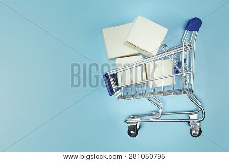 Online Shopping. Ecommerce And Delivery Service. Concept: Paper Cartons And Smartphone With A Shoppi