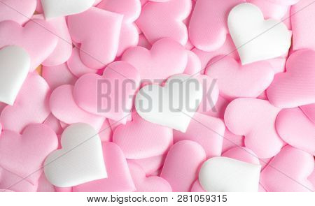 Valentine's Day hearts Background. Holiday Abstract Valentine Background with pink and white satin Heart. Hearts top view backdrop. Love concept, wedding. St. Valentine's Day. Flatlay