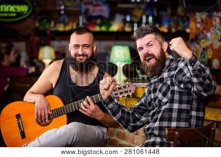 Live Music Concert. Man Play Guitar In Pub. Acoustic Performance In Pub. Hipster Brutal Bearded With