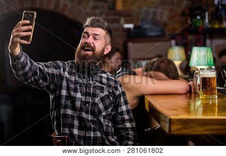 Taking Selfie Concept. Online Communication. Send Selfie To Friends Social Networks. Man In Bar Drin