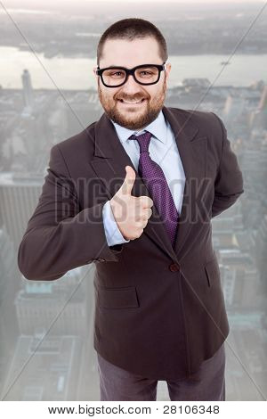 young silly business man going thumb up