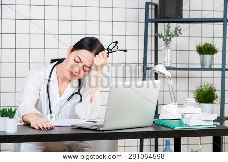 Closeup Portrait Sad Unhappy Health Care Professional With Headache Stressed Sleepy Holding Cup Of C
