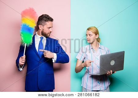 Changing Their Family Roles. Family Couple. Businessman And Housewife. Husband Stand With Dust Brush