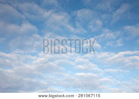 A full frame background image of high altitude cirrocumulus tropospheric clouds with blue sky poster
