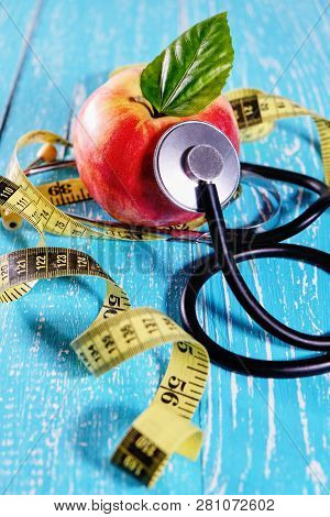 Health Care Check Up And Lose Weight For Health. Tape Measure For Body, Apple And Stethoscope On Woo