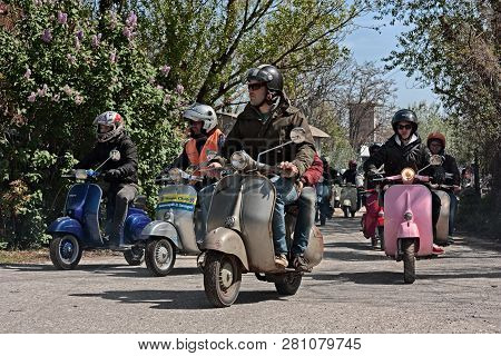Group Of Bikers Riding Vintage Italian Scooters Vespa And Lambretta In Motorcycle Rally Of Vespa Clu