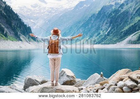 Traveler-image. Traveler Look At The Mountain Lake. Travel And Active Life Concept. Adventure And Tr