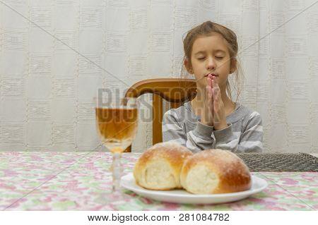 Child Prays At Shabbat. Little Jewish Sabbath