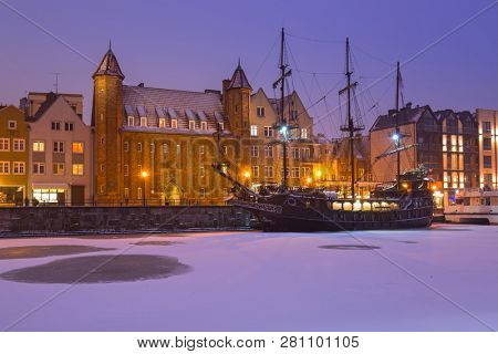 Old town of Gdansk over Motlawa river at snowy winter, Poland