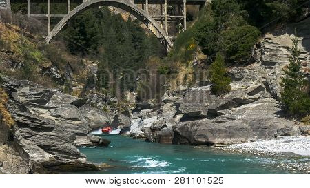 Long Shot Of The Shotover Jet And The Hstoric Edith Cavell Bridge Near Queenstown