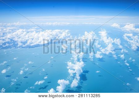 Ariel View Cloudscape Over Bluew Sea Background