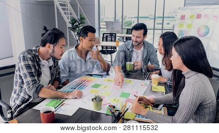 Creative Director Team Lead Brainstrom Branding Project With Designer Team At Meeting Table.discussi