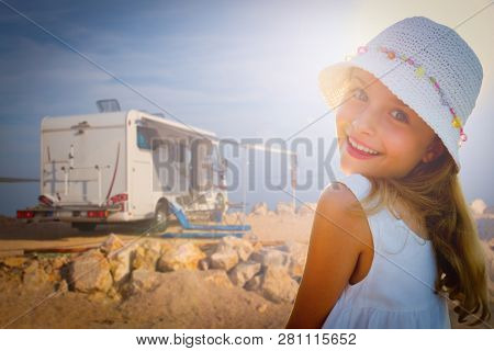 RV travel with camper, summer beach -happy smiling beauty girl on mototorhome vacation.