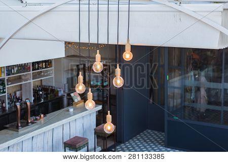 Lighting And Illumination Concept - Vintage Luxury Interior Lighting Decor In Cafe. Vintage Light Bu