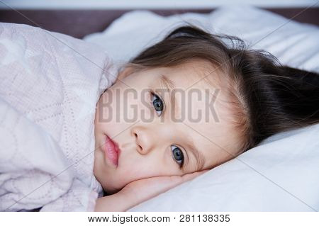 Little Girls Going To Sleep Lying On Bed. Sleep Schedule In Domestic Lifestyle. Cute Baby Child Port