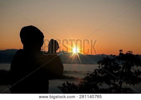 Silhouette Of Christian Man Hand Praying,spirituality And Religion,man Praying To God. Christianity