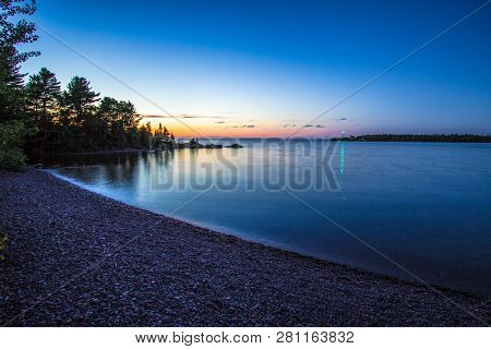The Blue Hour. Twilight Descends On A Remote Lake Superior Coast With The Light Of The Copper Harbor