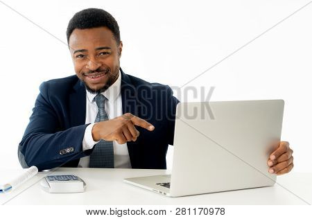 Attractive Happy Handsome African American Businessman Working On Laptop Computer On Desk At Office