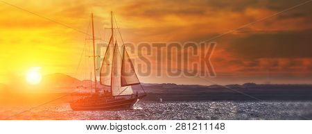 Old Ancient Ship On Peaceful Ocean At Sunset. Calm Waves Reflection, Sun Setting. Copy Space