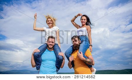 What We Would Call Fun. Happy Men Piggybacking Their Girlfriends. Playful Couples In Love Smiling On
