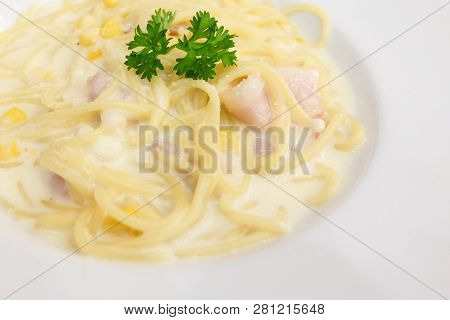 The Spaghetti Bacon, Corn And Cream Cheese With On White Dish Set On Table For Food Background Or Te