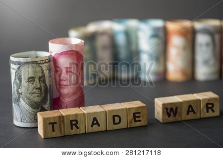China And Usa Trade War Wording On Wooden Cubes With Us Dollar And Yuan Banknote On Black Background