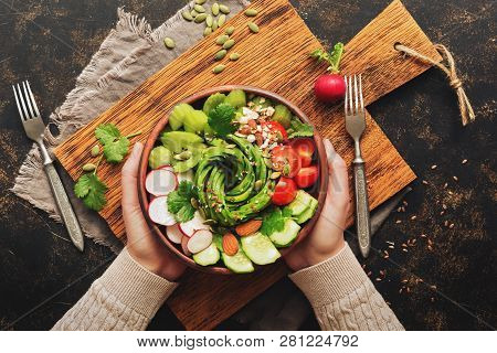 Healthy Vegan Diet Salad With Fresh Vegetables-avocado, Radish, Tomato, Cucumber, Celery, Nuts And S